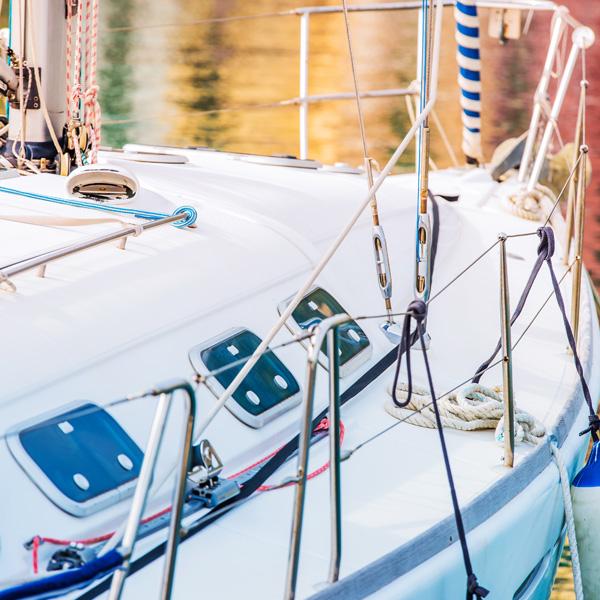 Yachting and Fishing Theme. Modern Yacht in the Marina Closeup Photo.