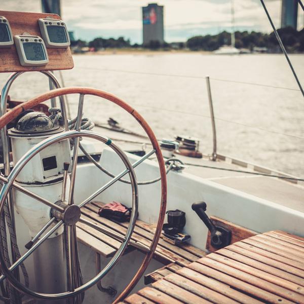 Steering wheel on a yacht.